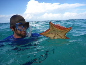 Ryan holding a starfish (and I think there's one on his head too!).  :)